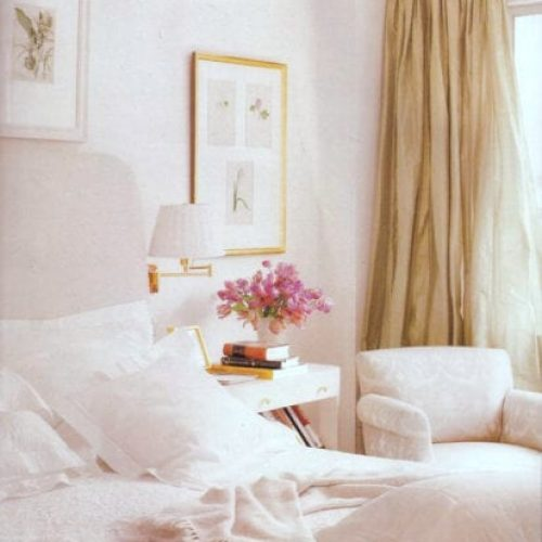 In the Master suite a custom padded upholstered head board. Across, a wall of builtin bookcases. Unlined taffeta curtains keep the rooms light and airy even on the dullest Manhattan day.