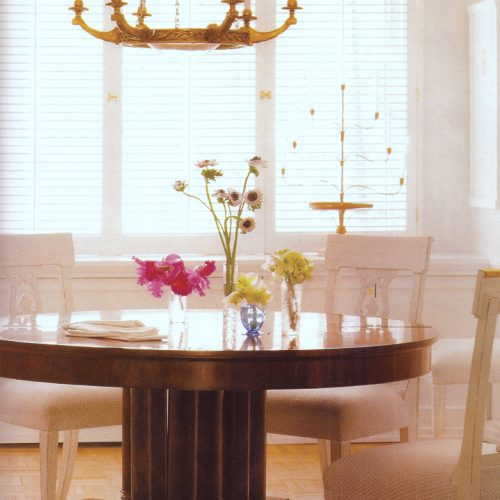 The dining room chairs are custom. The only real direction the clients gave me was a dining table to seat 20. I found an early 19th century Cuban mahogany round extending table that once restored sat 22. The arms of the period chandelier were copied down to the last detail as wall lights
